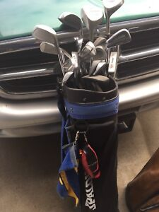 3 sets of golf clubs and bags
