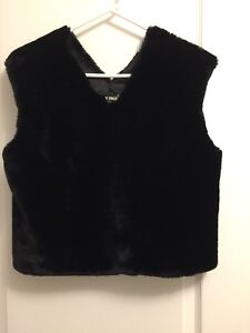 Black furry vest with lining