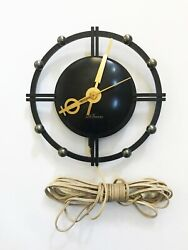 Seth Thomas Black and Bronze, Mid-Century Silhouette Electric Wall Clock