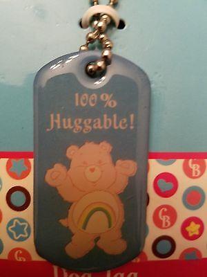 "Care Bears Cheer Bear Dog Tag Necklace ""100% Huggable!"" Pink Bear Rainbow Symbol - Cheer Bear Symbol"