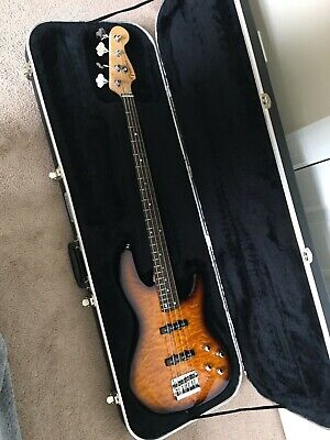 Fender Deluxe 24 Jazz Bass  2005? Quilt Top Tobacco burst with Hardshell case