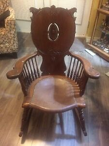 Antique rocking chair with leather seat. In good shape.