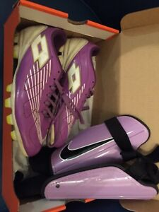 Girls soccer cleats and pads