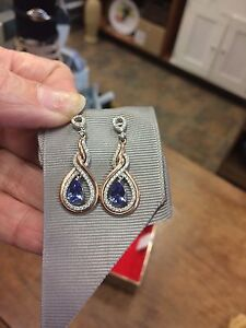 Stunning 14k Rose Gold Tanzanite stone with diamond earrings