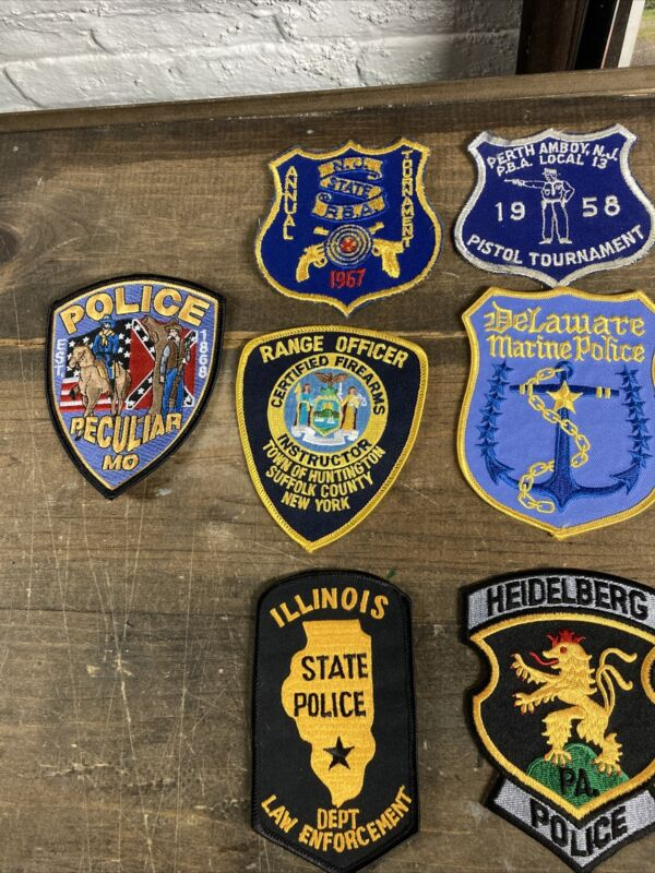 seven (7) Police patches. Different states.