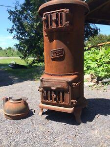 Antique upright wood stove