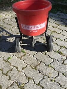 Grass seed / fertilizer spreader