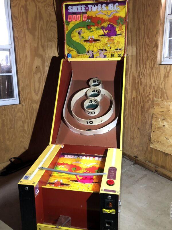 Skee Toss B.C. Arcade game Machine