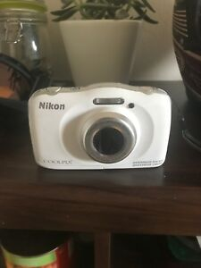 Nikon Coolpix (water proof camera with 16GB memory card)