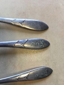 Three St Catherine's curling club spoons