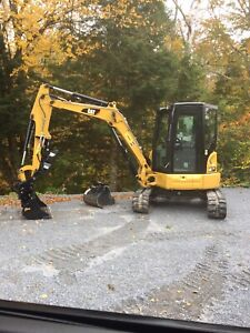 Tree service and rubber track excavator