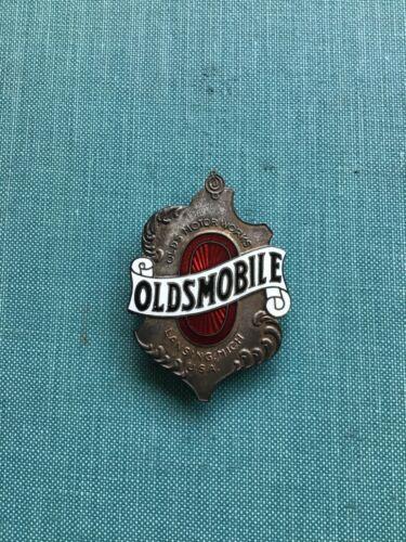Early  Oldsmobile emblem or factory badge.