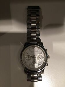 Authentic Michael Kors women's watch in silver