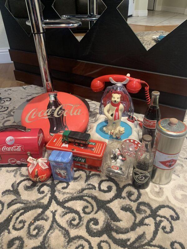Lot of 11 Coca Cola Items: 2x Bottles, 2x Ornaments, 3x Tins, 1 Car, 2x Phone