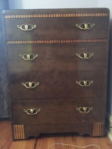 Antique highboy with brass handles
