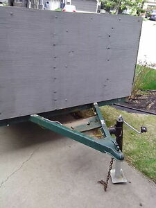 Flat deck utility trailer with two storage bins