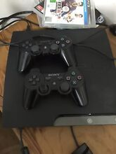 PS3 console two remotes and two games Darwin CBD Darwin City Preview