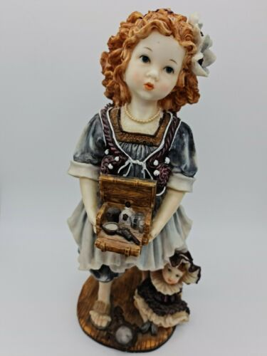 """Vintage handmade figurine """"Girl with a doll and toys"""". Portugal. 1980s"""