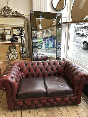 Oxblood 2 seater leather chesterfield sofa.