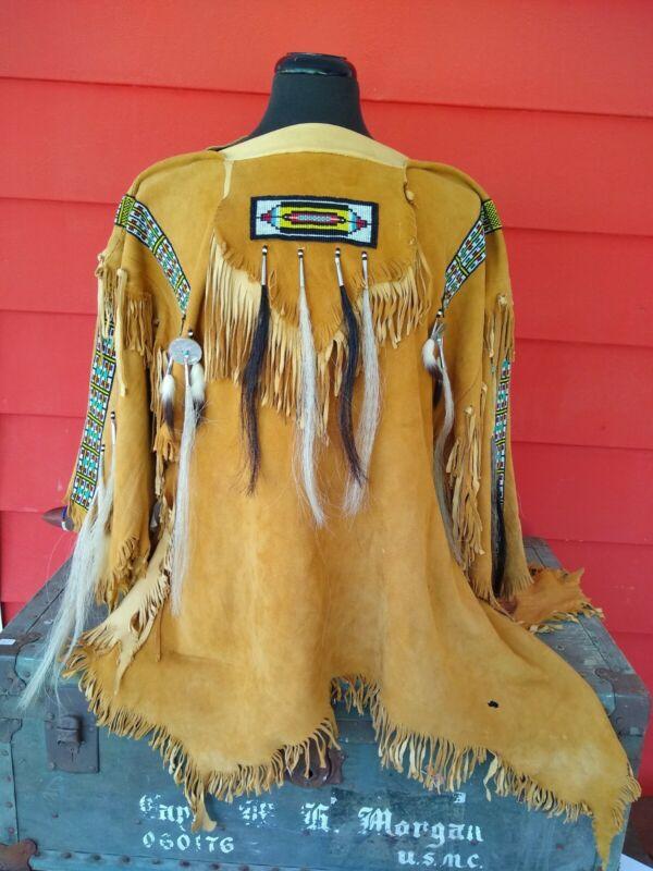 "Number 1004. Native Am. ceremonial ""Morning Sun"" buckskin shirt, signed by artis"