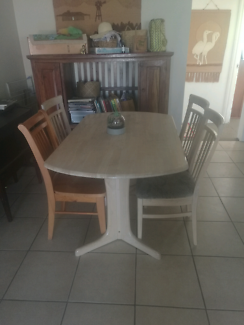 Wooden table and four chairs (one odd)
