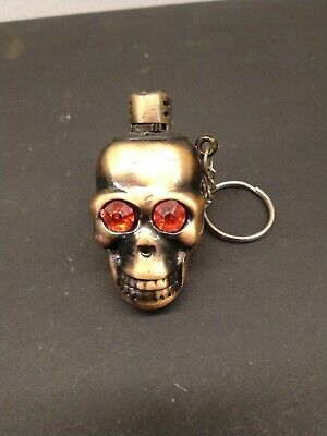 Vintage cast metal  head lighter with keyring