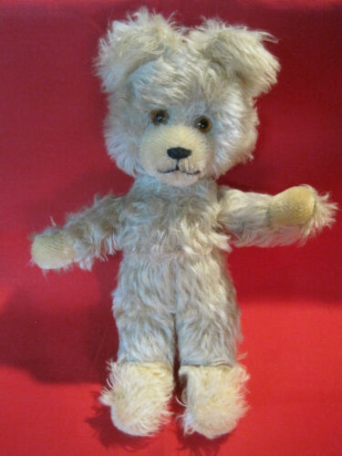 Vintage poseable mohair teddy bear with glass eyes, adorable face