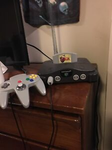 Nintendo 64 with 2 controllers and Zelda ocarina of time