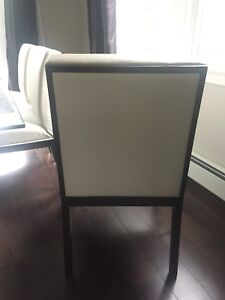 6 solid wood white pleather dinning chairs.