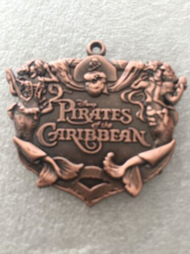 DISNEY PIN PIRATES OF THE CARIBBEAN COPPER COLOR - 1 PIN AS SHOWN A1