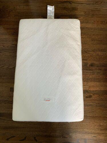 Babyletto non-toxic pure core mini crib mattress (waterproof cover) + 13 sheets