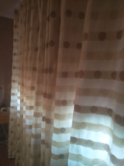 Creme coloured fabric curtains.