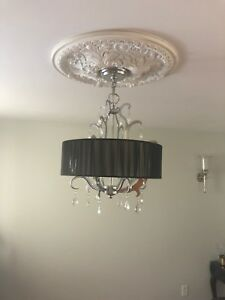 Hanging chandelier light and ceiling medallion (sold separately)