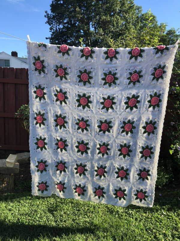 "Hand crocheted Knitted afghan. Pink Roses. 55"" X 72""."