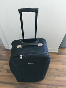 2 suitcases -one large and one small