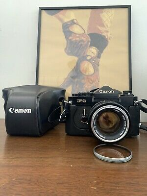 Canon F1 Eye Level Prism 55mm 1.2 Chrome Nose With Leather Case 35mm Film Camera