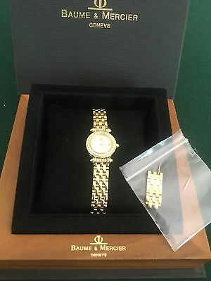 BAUME & MERCIER LADIES 18 k YELLOW GOLD WATCH WITH DIAMONDS