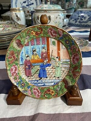 Antique Rose Medallion Chinese Lotus Nut Bowl And Tea Cups And Saucers Detailed In Gold And Red Trim Framing The Elegant Garden With Ladies