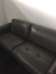 2 dark grey leather 3 seater couches