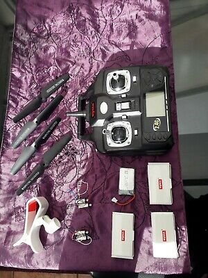 New Syma Drone flight controller and parts batteries and motors propelers holder