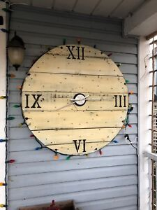 Reclaimed cable reel clocks