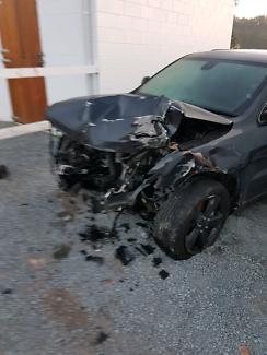 Wrecked black 2014 jeep grand cherokee black hawk