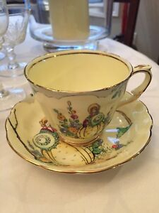 Crown Staffordshire Yellow Lady Teacup and Saucer '714109'