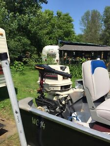 For Sale.  Boat Motor And Trailer