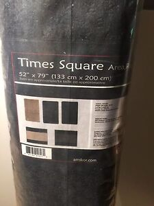 2 black area rugs, new $20 each