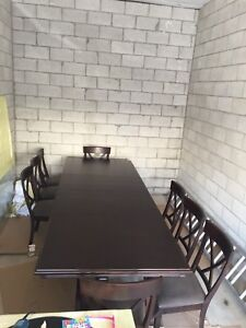 Custom made extendable dark wood dining room table and chairs