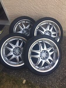 """17""""Aftermarket wheels & low pro tires"""