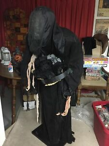 Robotic motion activated glowing skeleton butler. Halloween prop