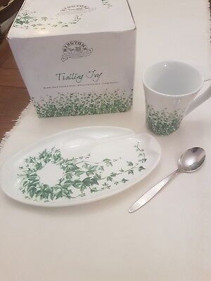 A Ringtons boxed beaker, snack saucer and spoon set.
