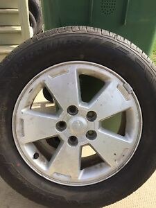 p225/60/16 inch All Season Tires on Chev Rims / LOTS OF TREAD
